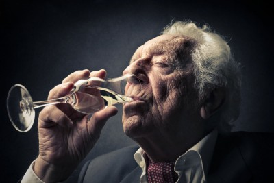 older man drinking
